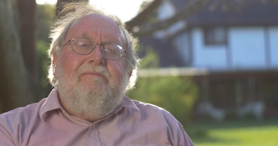 Portrait of grandfather elderly retired senior man at retirement age outdoors   Shutterstock HD Video #12357332