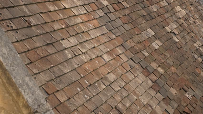 Ancient Type Terracota Clay Roof Tiles In Normandy France Weathered 4K  2160p 30fps UltraHD Tilt Video