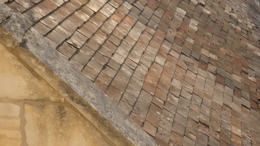 Ancient Terracota Clay Roof Tiles In Normandy France Weathered 4K 2160p  30fps UltraHD Tilt Video