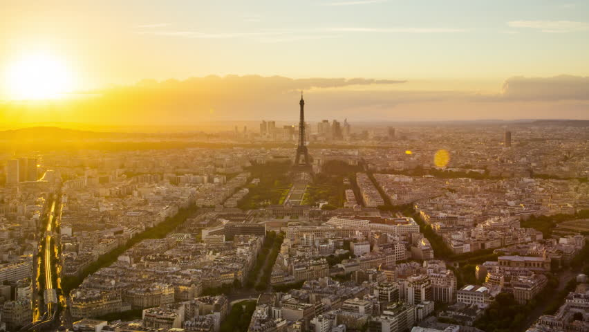 Day to night time lapse of sun setting over Paris skyline, seen from Tour Montparnasse 56, Paris, France