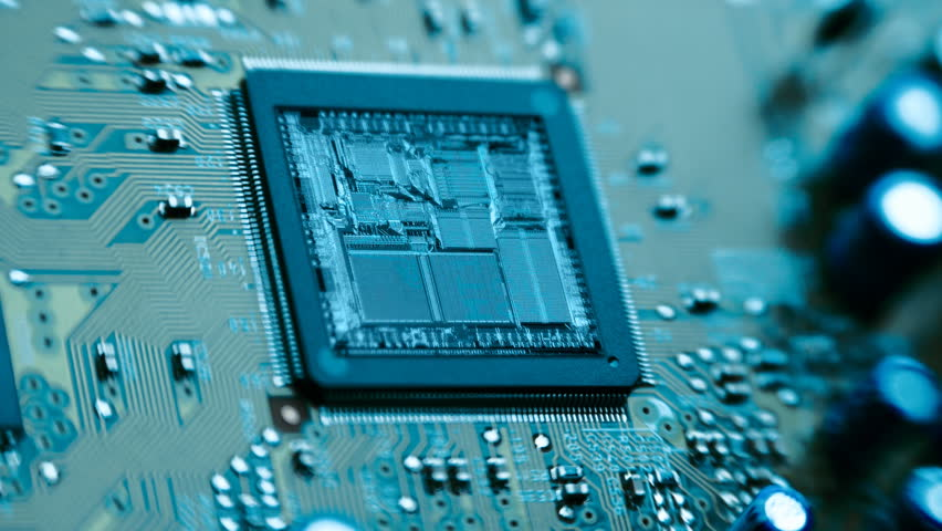 The microchip, the chip, the processor on the board rotates around the camera and glitter of internal structures. Macro. Closeup. The camera is rotating   Shutterstock HD Video #12419036