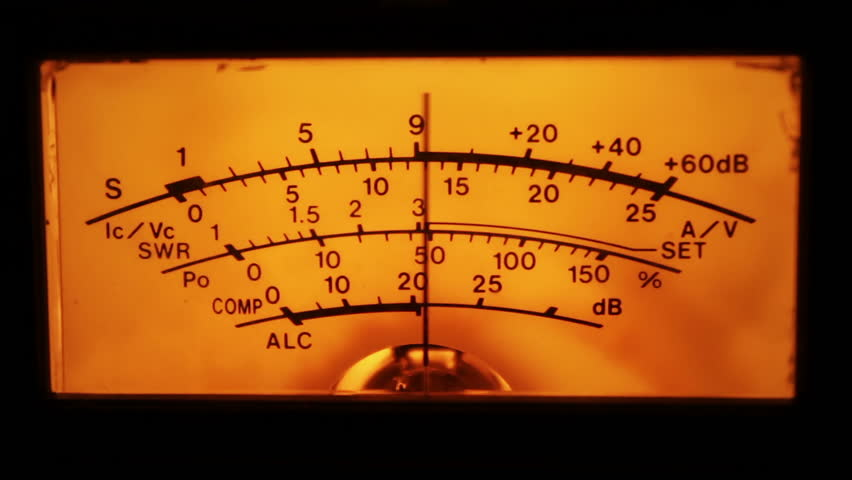 Dial indicator and signal level meter. Dial gauge modes transceiver radio stations close-up. Bright orange, yellow lights. Analog signal indicator.