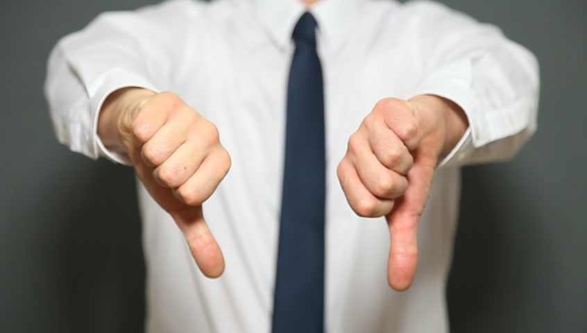 Businessman showing a sign of a downturn