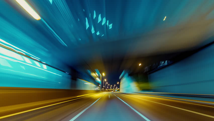 30p Driving pov modern highway timelapse/hyperlapse night, rapid speed, passing a series of tunnels.Camera outside the vehicle giving the illusion of teleporting through an series of turns,and tunnels #12429302