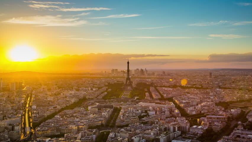 Paris - August 3rd, 2013: Time lapse footage of sunset over Eiffel Tower seen from Tour Montparnasse (Montparnasse 56), Paris, France | Shutterstock HD Video #12433112