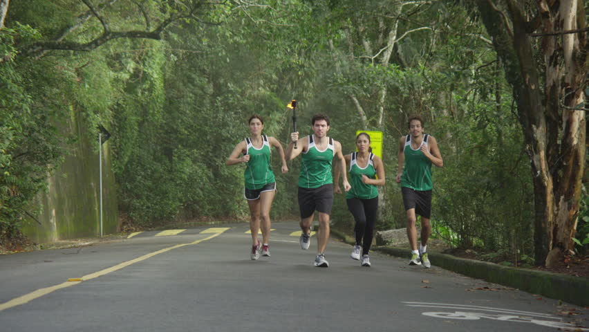 Slow motion olympic torch runners