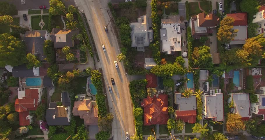 Top down aerial view of street traffic and residential neighborhood around Hollywood Boulevard, Los Angeles, California. 4K UHD.