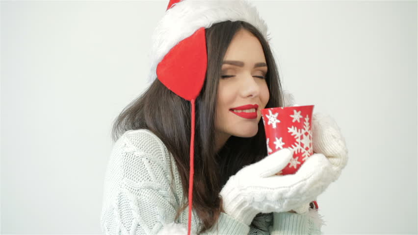 b82727ebd49d5 Santa Girl Holding Red Coffee Stock Footage Video (100% Royalty-free)  12436592