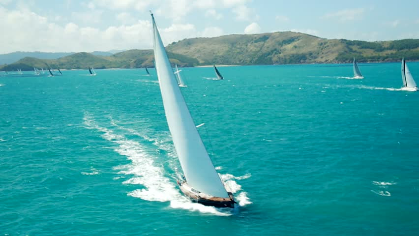 Aerial of yacht sailing amongst islands #12458492