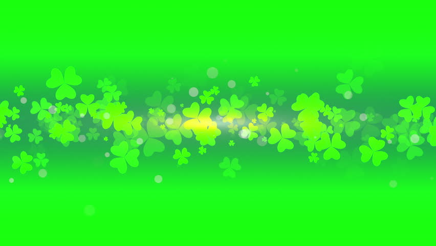 St. Patrick's animated clovers against a green and yellow vignette background. For use as a general backdrop, design element or as an overlay for placement of text or other copy. | Shutterstock HD Video #12460550