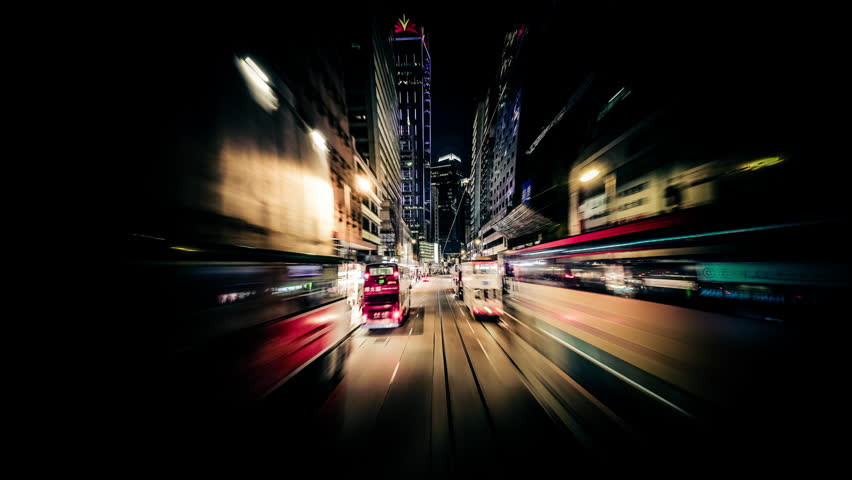 Time lapse moving through modern night city street with skyscrapers. Hong Kong. Abstract cityscape traffic background with motion blur | Shutterstock HD Video #12472802