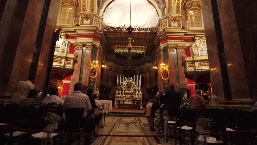 Detail of a traditional church during mass in Malta, Valletta -- June 2015.