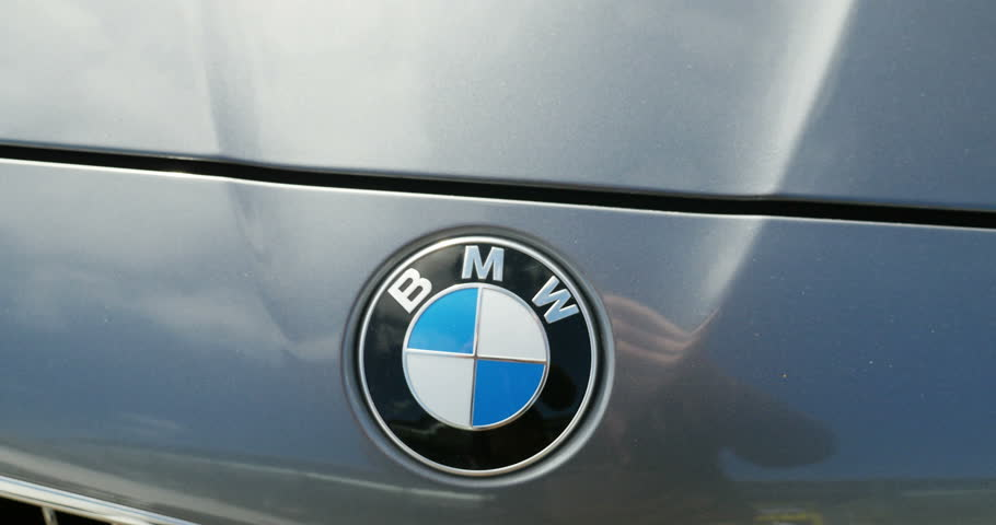 STRASBOURG, FRANCE - CIRCA 2015:  Panning over BMW logotype on a gray car. Bayerische Motoren Werke or BMW is on e of the most appreciated car worldwide