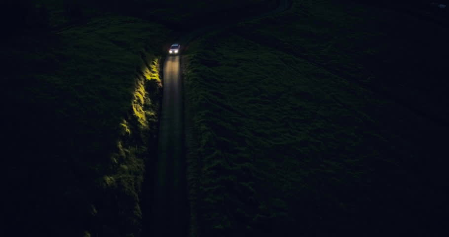 Aerial View Car Headlights Night Driving on Winding Country Road