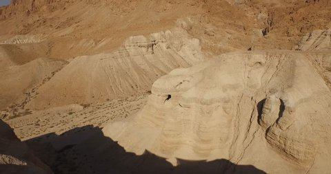 Soaring aerial view above the Dead Sea Scroll caves in Qumran, Israel. Filmed using a DJI Inspire drone.