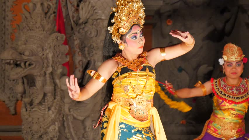 Two Balinese Dancers Dancing Performing On Stage