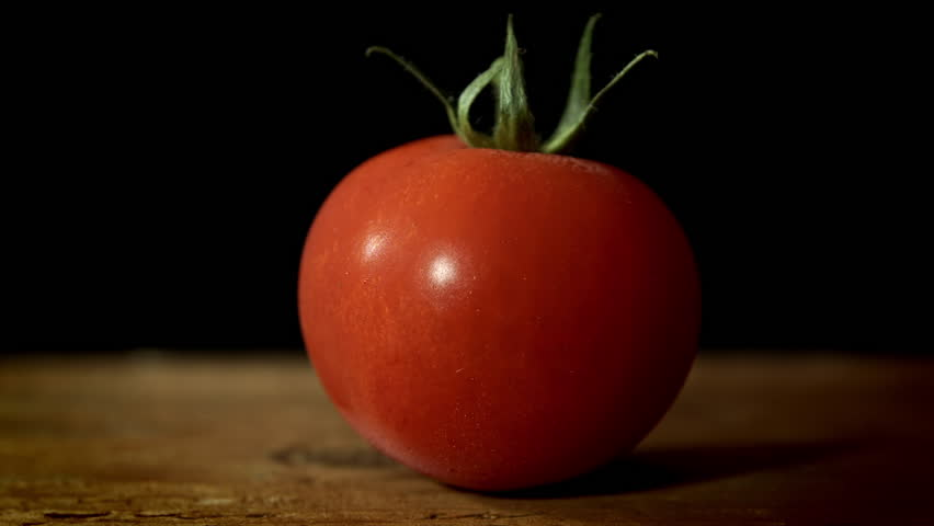 Image result for tomato with black background