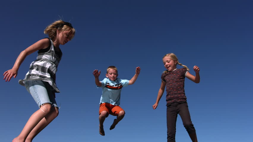 Cinemagraph - Kids jumping on trampoline. Motion Photo.