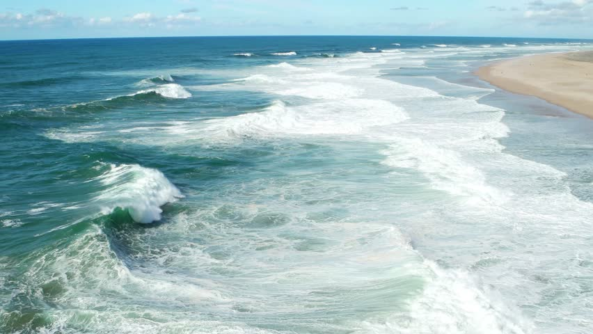 ow Season at the Beach with Waves in Nazare, Portugal