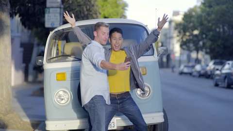 Excited Gay Couple Pose For Road Trip Photos In Front Of Camper Van