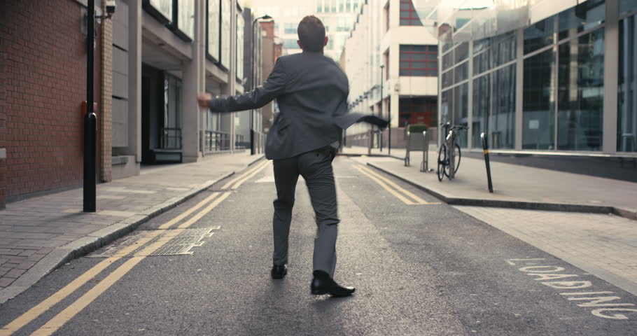 Businessman dancing Contemporary happy funky caucasian street dancer freestyle in the city #12658352