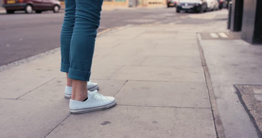 Feet dance closeup caucasian man funky street dancer dancing freestyle in the city