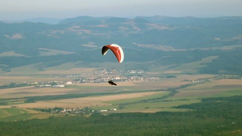 Colorful hang glider in sky over valley, Slovakia
