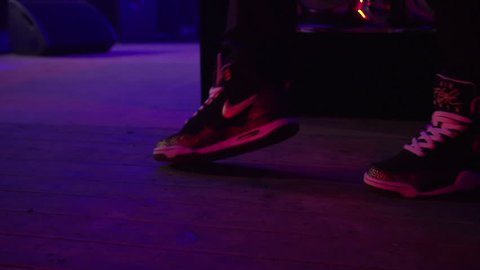 GRONINGEN, NETHERLANDS - APRIL 11: Dancing shoes from an MC on stage on April 11, 2015 in Groningen, Holland [SLOMO]