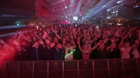GRONINGEN, NETHERLANDS - APRIL 11: Big crowd / audience dancing and jumping  at the Sunsation Dance Event on April 11, 2015 in Groningen, Holland.