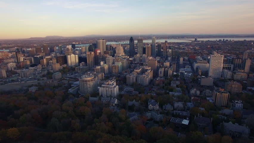 4K aerial drone shot of montreal skyline high forward move at sunset