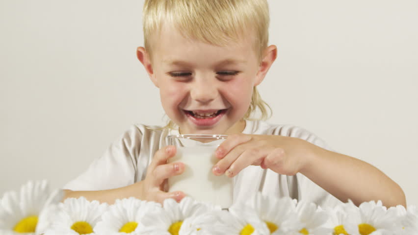 Boy drinking milk.