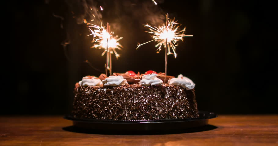 Stock Video Clip of Chocolate cake with candles to celebrate the