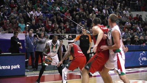 KRASNODAR, RUSSIA - NOVEMBER 6, 2015: Slow motion PINAR KARSIYAKA IZMIR vs. LOKOMOTIV KUBAN KRASNODAR Turkish Airlines Euroleague Basketball Tournament in Basket Hall, KRASNODAR, RUSSIA NOV, 6, 2015