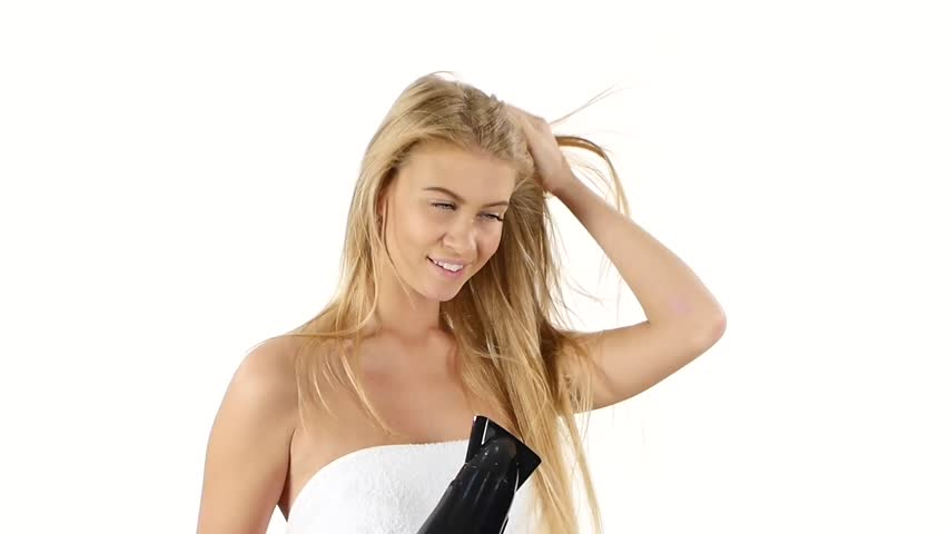 woman in bathroom drying hair with blow dryer, lovely woman in towel. white background. Close up, Black hair dryer. slow motion, bathroom
