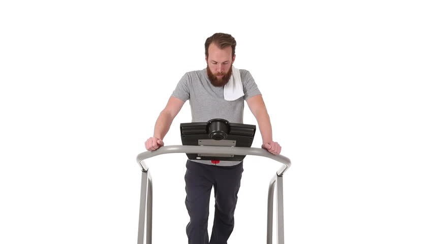Adult male walking on treadmill, extremely exhausted and out of shape.