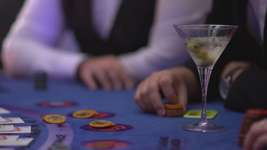 Gambling Black Jack in a casino - Gambler asking for cards - James Bond style | Shutterstock HD Video #12838502