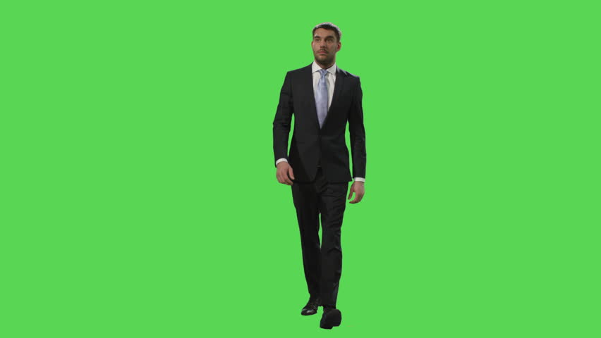 Businessman in a suit is walking on a mock-up green screen in the background. Shot on RED Cinema Camera in 4K (UHD). | Shutterstock HD Video #12886118