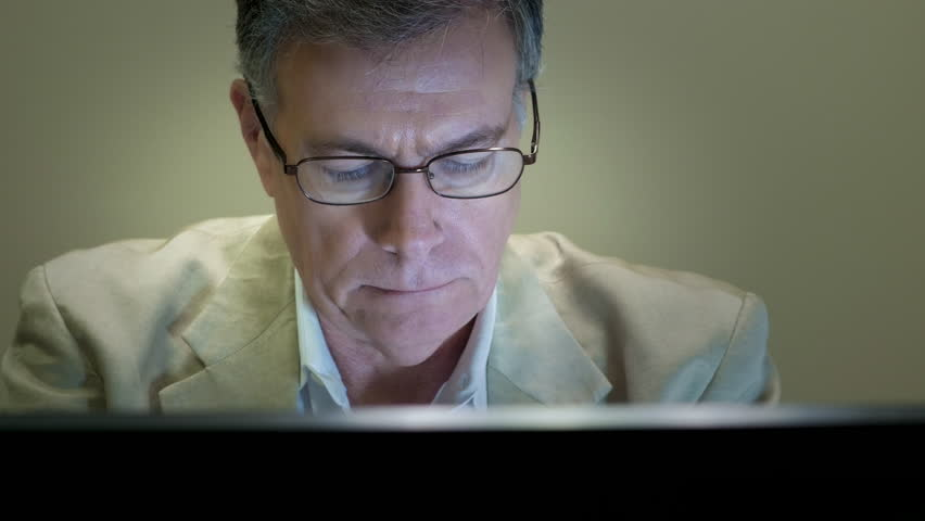 Businessman working takes off glasses and smiles at camera | Shutterstock HD Video #12889484