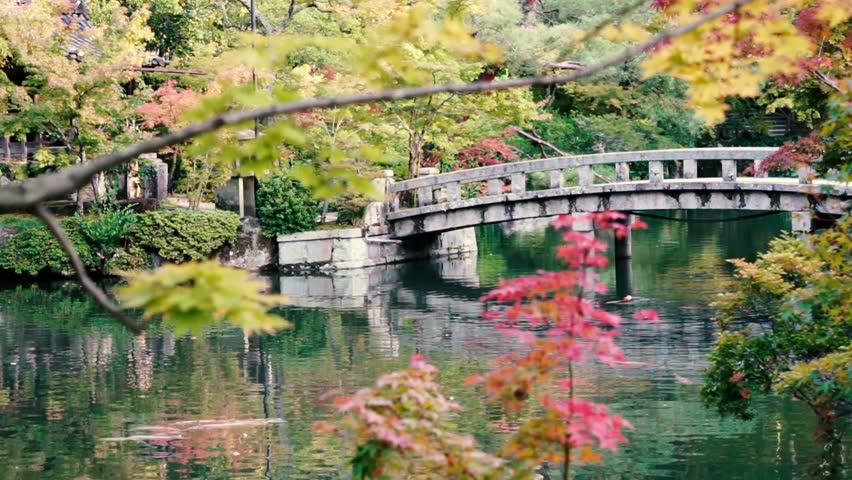 kyoto japan october 2015 a stone bridge crosses to an island on a