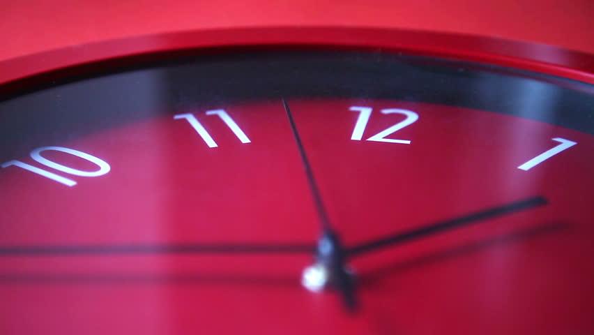 Red wall clock workingand rewinding | Shutterstock HD Video #12978992