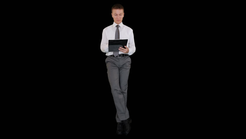 Young businessman writting on a clipboard and sitting, Alpha Channel | Shutterstock HD Video #12999182