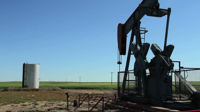 Crude oil pump jack with storage tank