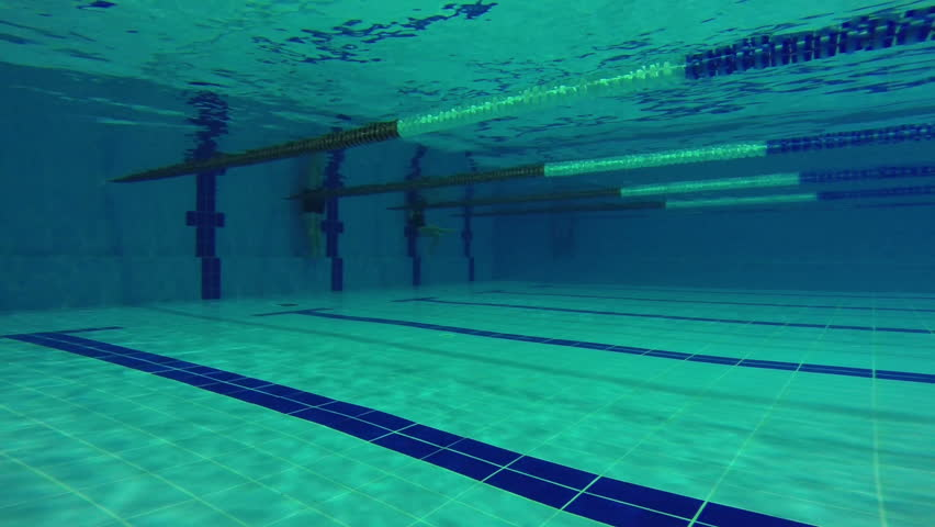 Pool . A Swimmer Dives Into The Launch Pad.   HD Stock Footage Clip