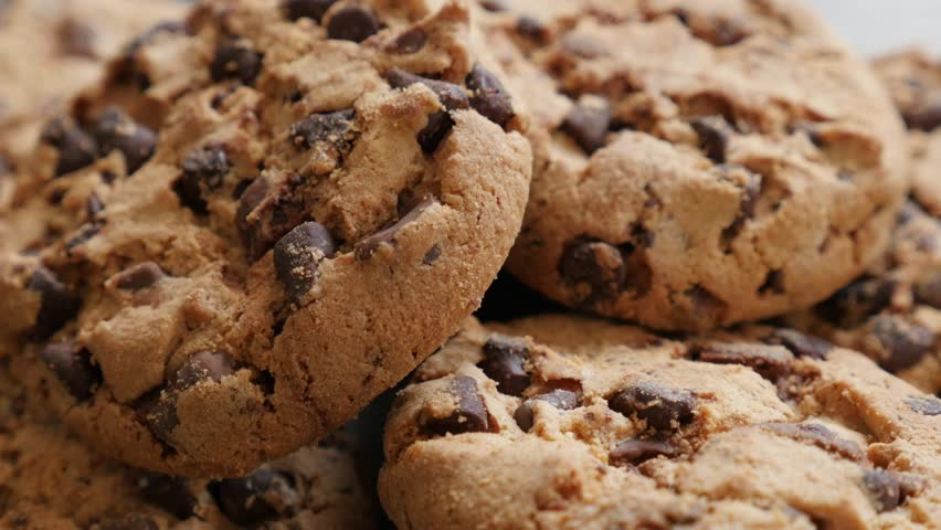 Lot of chip cake cookies with chocolate close-up tilting 4K 3840X2160 30fps UHD footage - Slow tilting on biscuit cookies arranged on table 4K 2160p UltraHD video