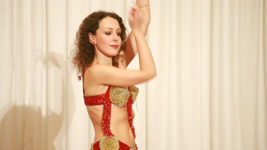 Beautiful eastern dancer in red perform bellydance, closeup view | Shutterstock HD Video #1301452