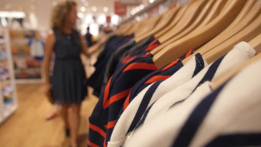 Woman Choosing Clothes on Hanger in Clothing Store. Clsoeup. HD, 1920x1080.    | Shutterstock HD Video #13019372