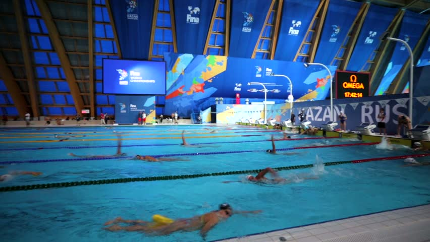 KAZAN, RUSSIA   27 JULY 2015: Athletes Swimmers Train In A Pool Of Aquatics