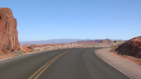Driving USA: point of view car shot of magnificent desert landscape in Valley of Fire, Nevada