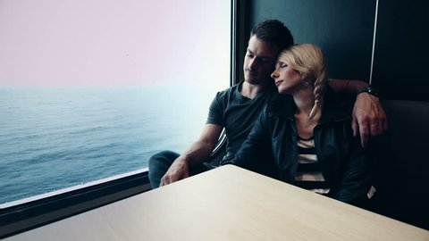 Motion-Photo (Cinemagraph) of Young Couple Sleeping on a Ferry Boat