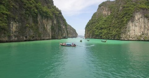Stunning aerial shot of Phi Phi islands in Thailand with boats in foreground